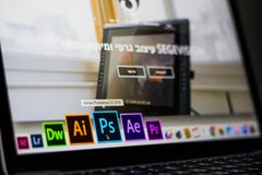 Turned on Laptop on Desktop With Hovered Adobe Photoshop Cc Application Stock Photo