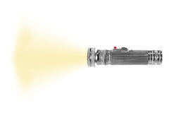 Turned on metal flashlight isolated Stock Photography