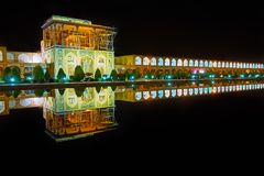 Black mirror of Naqsh-e Jahan square, Isfahan, Iran. The turned off fountain in the middle of Naqsh-e Jahan square serves as the mirror, reflecting  bright Royalty Free Stock Photo