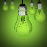 Turned off light bulb on green background. Light bulb on green background and more bulbs Royalty Free Stock Images