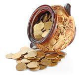 Turned pot with coins Stock Photo