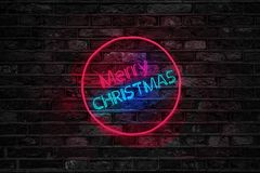 Turned on Red and Blue Merry Christmas Neon Sign Royalty Free Stock Image