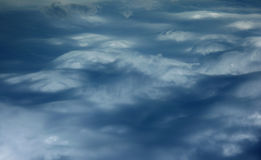 Turned sky looks like mountain in clouds Royalty Free Stock Photo