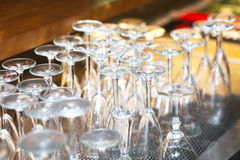 Turned upside down a set of wine glasses. Before the party stock photos