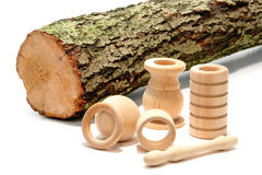 Turned Wood Parts and Raw Tree Log Royalty Free Stock Photo
