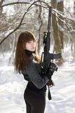 Turned lady with the gun Stock Image