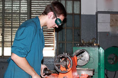 Turner. Young learning to use a lathe industrial Stock Photos