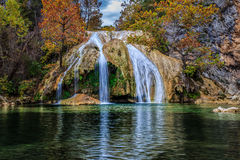 Turner Falls 4. Turner Falls, at 77 feet (23 m), is locally considered Oklahoma's tallest waterfall, although its height matches one in Natural Falls State Park Royalty Free Stock Image