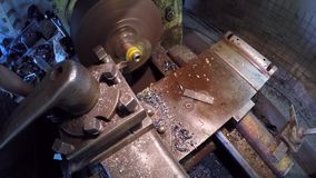 Turner Grinding Plastic Bushing. CLOSE UP: Slow motion of a turner working at workshop grinding plastic bushing while making it using special machine-tool which stock video footage