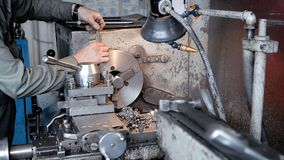 The turner grinds the part on the lathe. Metal working of metals by cutting stock footage