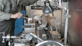 The turner grinds the part on the lathe. Metal working of metals by cutting stock video