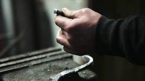 Turner put a mark for the hole in the blacksmith`s mite. stock video footage