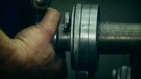 Turner Working With Industrial Lathe. Archival stock footage