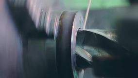 Turner is working on a turning lathe at the metal constructions factory stock footage