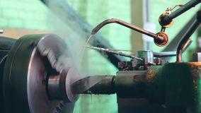Turner is working on a turning lathe at the metal constructions factory. Heavy industry and metalwork. Accuracy metal cutting and detail drilling stock video footage