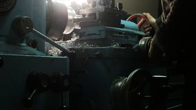 Turner is working on a turning lathe at the metal constructions factory. Metal industry stock photo