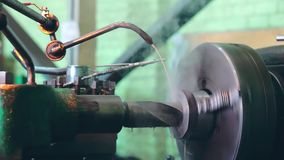 Turner is working on a turning lathe at the metal constructions factory. Heavy industry and metalwork. Accuracy metal cutting and detail drilling stock footage