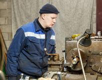 Turner works for lathe. Turner is working on the machine.metal processing Stock Photos