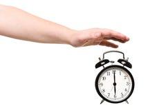 Turning of the Alarm Clock stock photos