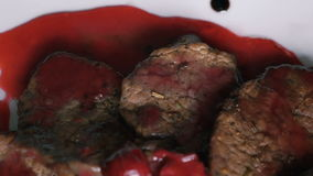 Turning around dish of meat and red sauce on the plate stock footage