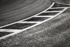 Turning asphalt road with dividing lines Royalty Free Stock Photo