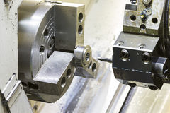 Turning automotive part by cnc lathe royalty free stock images