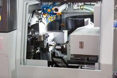 Turning automotive part by cnc lathe. Turning high precision automotive part by cnc lathe stock photos