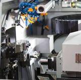 Turning automotive part by cnc lathe royalty free stock image