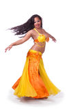 Turning bellydancer in yellow and orange Stock Photo