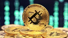 Turning bitcoin with changed numbers in backgrounds stock video