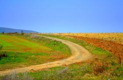 Turning country road colorful nature Royalty Free Stock Photos