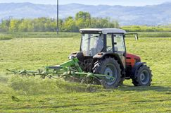Turning cut hay Stock Photography
