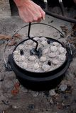 Turning a dutch oven lid Stock Photo