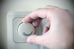 Turning Electric Switch. Hand Turning Electric Switch On stock photo