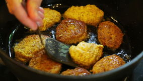 Turning frying vegetarian cutlets stock video footage