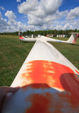 Turning a Glider by Hand. MANOTICK, CANADA – AUGUST 19: Turning a glider by hand on the grass airstrip at Rideau Valley Soaring on August 19, 2012 in stock photo