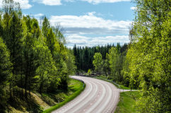 Turning highway. Turning highway between green nature trees and blue sky stock photography