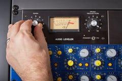 Turning knob on audio equipment Stock Images