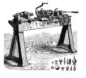 Turning lathe with accessories, vintage engraving. Metalworking, turning bench lathe with cone heads and accessories, vintage engraving Stock Images