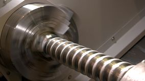 Turning lathe in action, closeup. Metal mechanism with a spiral stock video footage