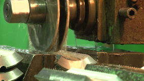 Turning lathe in action. Facing operation of a metal blank on turning machine with cutting tool.Old turning lathe machine in turning workshop.Operator machining stock video