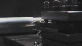 Turning lathe in action.Facing operation of a metal blank on turning machine with cutting tool.