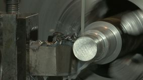Turning lathe in action. Action of turning lathe. Piece of metal spinning. Power and precision stock footage