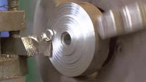 Turning Lathe Cuts Metal. Slose-up Shot. Shot with SONY FS700 and Canon lens stock video