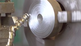 Turning Lathe Cuts Metal. Slose-up Shot. Shot with SONY FS700 and Canon lens slow motion stock video footage