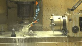 Turning lathe in operation. Close-up of working process of lathe and moulding machine with numerical control. New electric tool cut and drill molds with oil or stock video footage