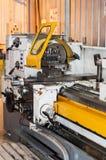 Turning lathe before workshop. Industrial area. Lathe mashine on site Royalty Free Stock Photography