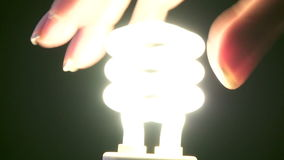 Turning on Light Bulb stock video footage