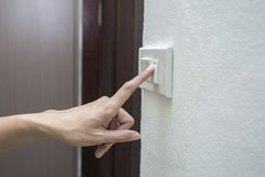 Turning on light switch Stock Images