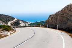 Turning mountain highway with blue sky and sea Royalty Free Stock Photography